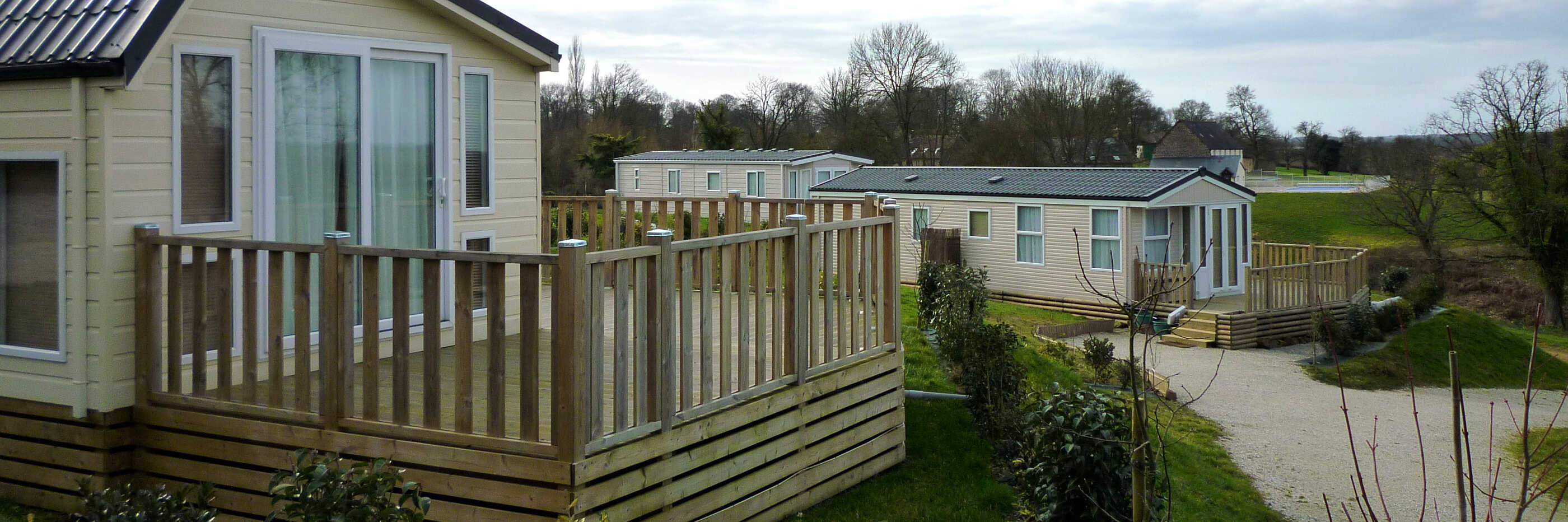 Photo of three park homes sited at Parc Mayenne.