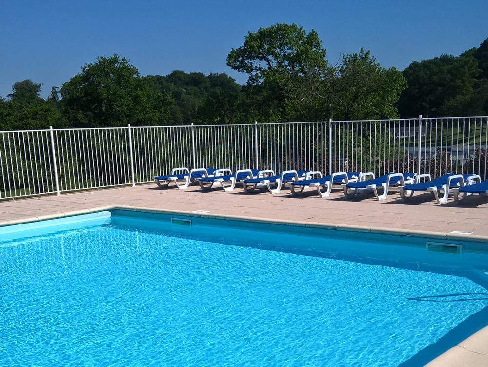 Photo of Parc Mayenne's swimming pool with several sun loungers around it